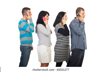 Four people standing in profile in a line and speaking by cell phones isolated on white background