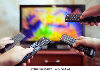 Four people with tv controllers