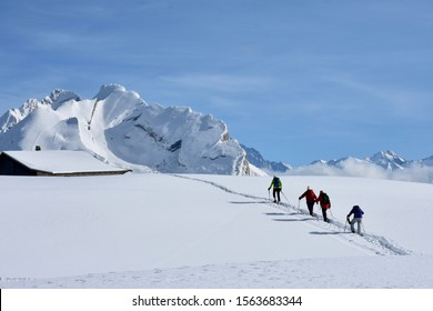 Four people who make a beautiful winter walk in la Clusaz in the Haute-Savoie.