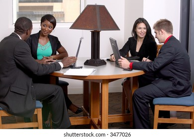 four people working on a team together