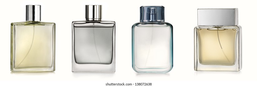 Four perfume spray bottles