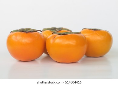 Four persimmons