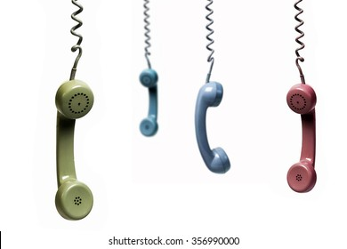 Four phones hanging from several colors isolated on a white background
