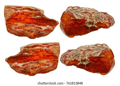 Four pieces of amber on a white background. Natural mineral, hardened ancient resin of red color. A collage of amber pieces. Sun stone as a background for advertising layouts. Amber background.