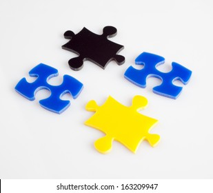 Four pieces of puzzle of color metaphor solution, business concept images