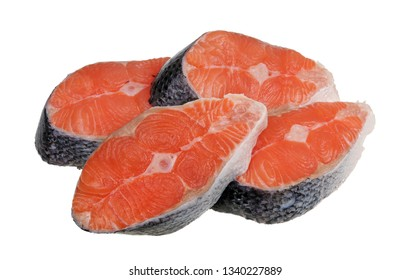 Four pieces of real fresh salmon fish steaks from city market. Isolated on white studio macro
