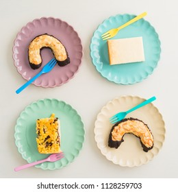 Four pieces of sweet pastry on pastel coloured plates
