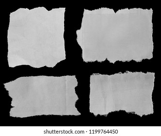 Four pieces of torn paper on black