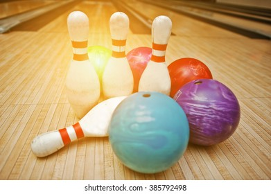 Four pins with five bowling balls