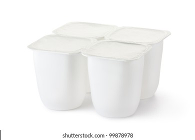Four plastic container for dairy products with foil lid. Isolated on a white.