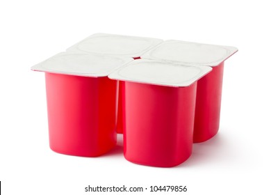Four plastic containers for dairy products with foil lid. Isolated on a white.