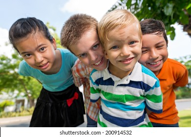 Four playful kids looking at the camera