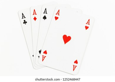 Four playing cards of Aces isolated on white background