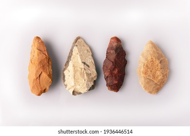 four prehistoric quartzite spearheads. From the Atherian lithic industry. From the Paleolithic and Acheulean culture, from the Sahara desert. On white background