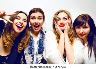 c7a6d5945 Four pretty funny girls making selfie at crazy party, funny grimaces and  fun, black
