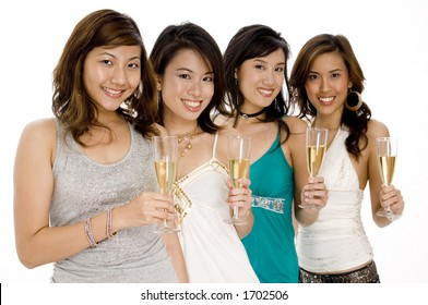 Four pretty young asian women with glasses of champagne