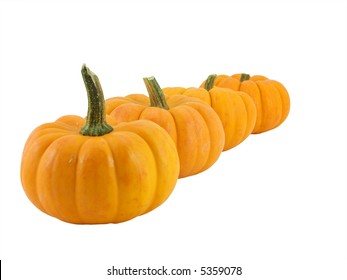 Four pumpkins isolated on white