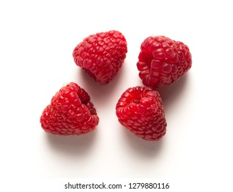 four raspberries on white table, with shadow