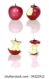four red apples and apple cores over white