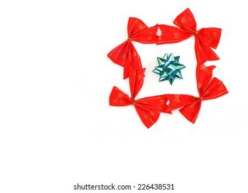 four red Christmas ribbons with a gift box bow in the middle