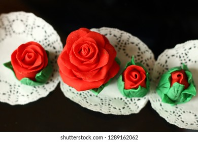 Four Red cupcake roses made of mastic ready for gift