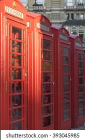 Four red phone booths in a row in London, UK