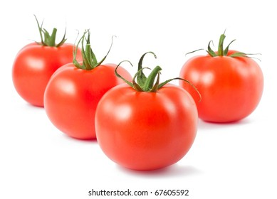 Four red ripe tomatoes on white background