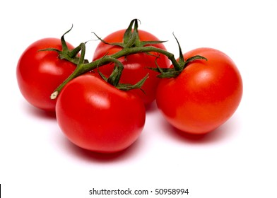 Four red tomatoes on a branch