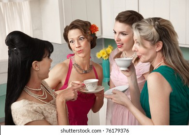 Four retro-styled women chit-chat over coffee in a kitchen