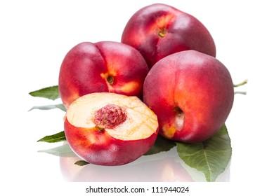 Four ripe nectarines isolated on white background