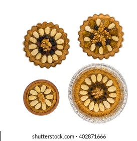 """Four round traditional Polish Easter cakes """"Mazurek"""" with almonds, raisins and walnuts on the white background"""