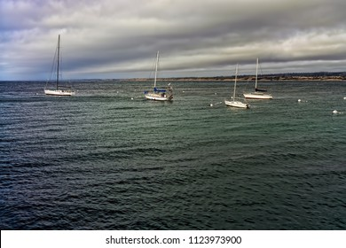 Four sailing Yachts on monterey bay under cloudy skies