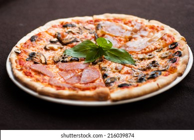 Four Season Pizza slice on the wooden table