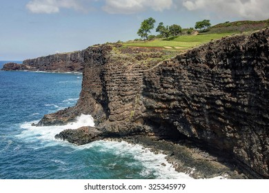 """Four Seasons Manele Bay Golf Course - Signature 12th Hole - Island of Lanai, Hawaii.  View from the coastal hiking trail known as, """"The Fisherman's Trail""""."""