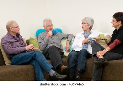 Four seniors discussing some things while drinking coffee