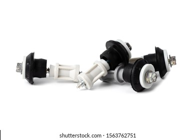 Four shipping bolts with gaskets inserted into the back of the Washing Machine during transportation, isolated on white background