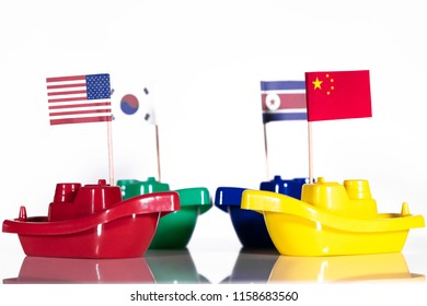 four ships with the flags of united states, russia, north and south korea, concept like border conflict, war or peace with protecting power
