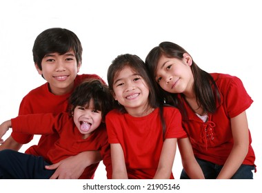 FOur siblings with red shirts isolated on white