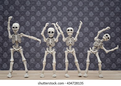 Four skeletons form LOVE with hand signs