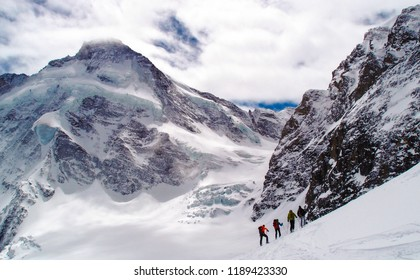Four ski mountaineers below the Matterhorn near Zermatt in the Swiss alps
