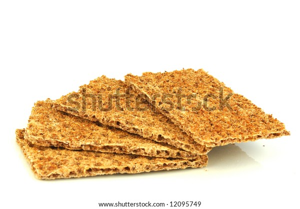 Four slices of healthy brown delicious rye crisp bread on a plate isolated on white background