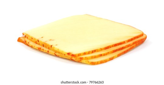 Four slices of muenster cheese on a white background.