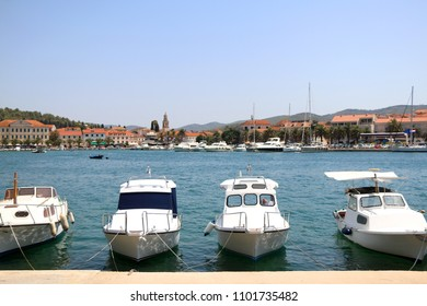Four small boats in harbor of Vela Luka, Korcula island, Croatia. Vela Luka is a popular summer travel destination.