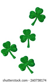 Four sparkling green shamrocks isolated on a white vertical background with space for text, perfect for Saint Patrick's Day