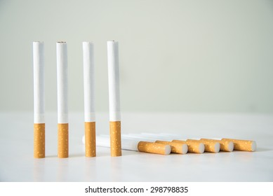 four stand Cigarettes on white table
