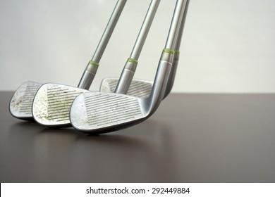Four standing golf clubs