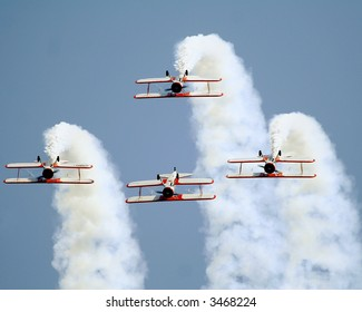 Four Stearman bi-planes flying in synchronisation