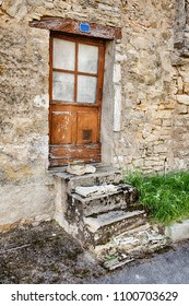 Four steps leads to a small door in the village of Santenay in the Burgundy region of France.
