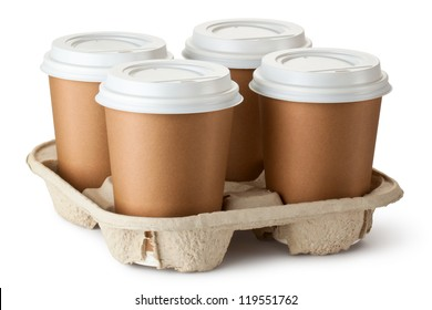 Four take-out coffee in holder. Isolated on a white.