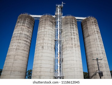 Four tall storage silos, Agricultural industrial containers.